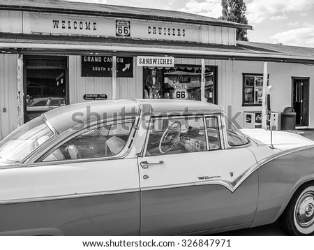 Williams, Arizona, United States - June 14, 2007: Classic car parked near a typical gift shop in town on the road sixty-six. Balck and white. - stock photo
