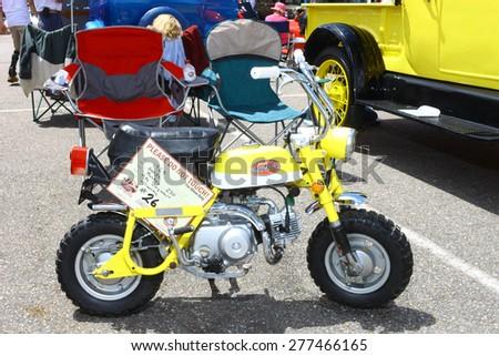 WILLIAMSBURG, VA - May 9, 2015: A 1969 Honda Monkey Z50 mini trail minibike at the 6th Annual Project Lifesaver Car Show in Williamsburg Virginia on a summer day. - stock photo