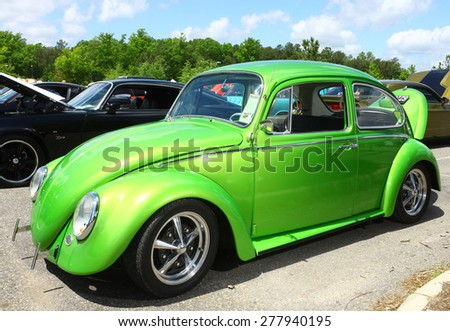 WILLIAMSBURG, VA - May 9, 2015: A lime green Volkswagon Beetle on display at the 6th Annual Project Lifesaver Car Show in Williamsburg Virginia on a summer day. - stock photo