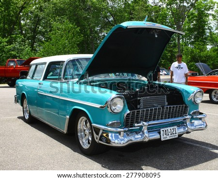 WILLIAMSBURG, VA - May 9, 2015: A turquoise 1955 Chevy Nomad station wagon at the 6th Annual Project Lifesaver Car Show in Williamsburg Virginia on a summer day. - stock photo