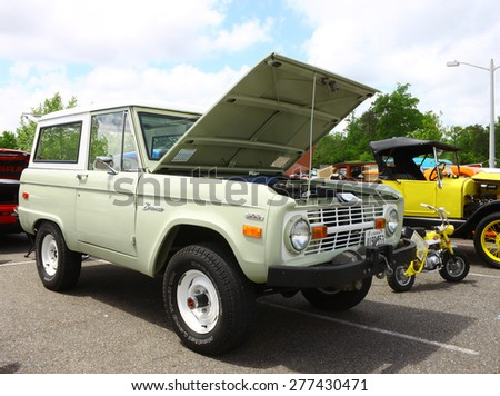 WILLIAMSBURG, VA - May 9, 2015: A vintage 1971 Ford Bronco 302 4X4 SUV at the 6th Annual Project Lifesaver Car Show in Williamsburg Virginia on a summer day. - stock photo