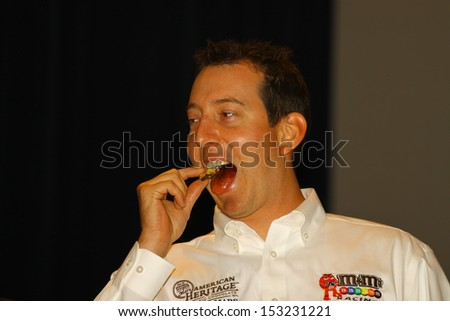 WILLIAMSBURG, VA- SEPTEMBER 5: Kyle Busch preparing to eat His wife Samanthas fresh made Chocolate at the 1st History meets Horsepower show in Williamsburg, Virginia on September 5, 2013 - stock photo