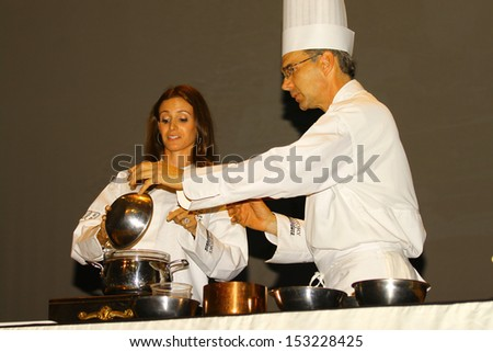 WILLIAMSBURG, VA- SEPTEMBER 5: Samantha Bush and Colonial Williamsburg chef Rhys Lewis prepare Chocolate at the 1st History meets Horsepower show in Williamsburg, Virginia on September 5, 2013 - stock photo