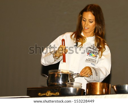 WILLIAMSBURG, VA- SEPTEMBER 5: Samantha Bush preparing Chocolate at the 1st History meets Horsepower show in Williamsburg, Virginia on September 5, 2013 - stock photo