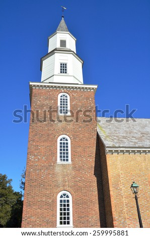 WILLIAMSBURG, VIRGINIA - NOVEMBER 19 2014: Bruton Parish Church located in the restored area of Colonial Williamsburg Virginia, United States on Duke of Gloucester Street..  - stock photo