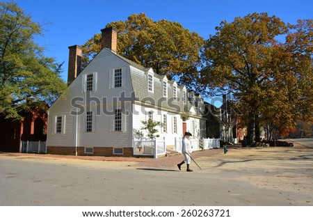 WILLIAMSBURG, VIRGINIA - NOVEMBER 19 2014: Duke of Gloucester Street in Colonial Williamsburg. The restored town is a living-history museum and a major attraction for tourists and field trips. - stock photo