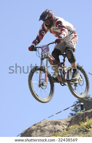 WILLINGEN, GER - JUNE 13, Mountain biker Marcel Basener (GER) #150, racing at downhill competition, amateur class 4th place-qualifying for pro class race, Willingen, Germany, June 13, 2009 - stock photo
