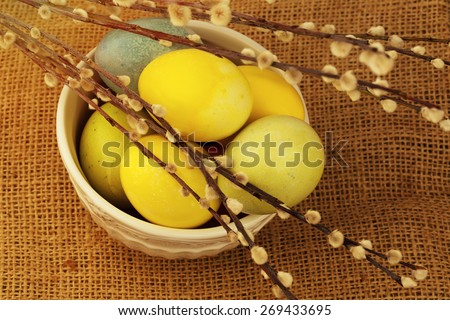 Willow Spring & Easter eggs painted still life toned photo selective soft focus - stock photo