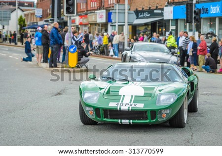 Wilmslow UK - July 9, 2013 : A Ford GT40 during the annual public gathering of local sports and super cars in affluent Wilmslow, Cheshire - stock photo