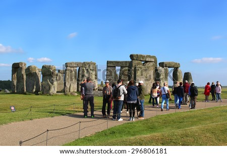 WILTSHIRE,UNITED KINGDOM, June 19, 2015: People visiting Stonehenge on the lush countryside of England in Wiltshire - stock photo