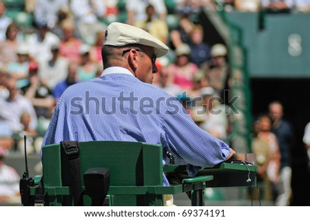WIMBLEDON, LONDON - JUNE 23: An Umpire presides over a match at the Wimbledon Championships on June 23, 2009