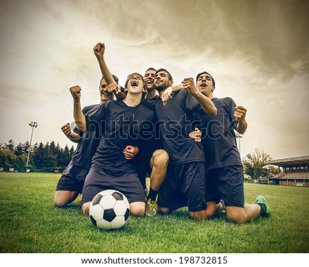 win for the team - stock photo