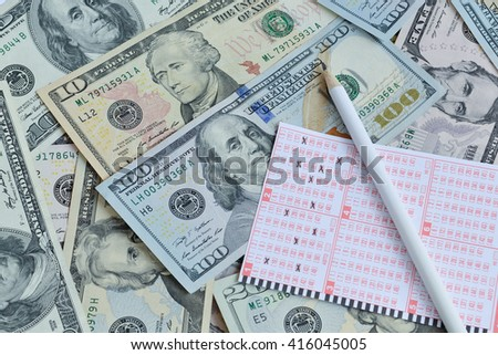 Win the lottery. Lottery ticket and pencil on dollar background