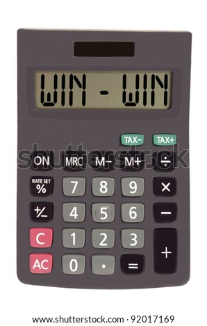 win - win on display of an old calculator on white background - stock photo