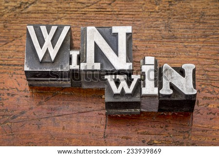win-win strategy in mixed vintage metal type printing blocks over grunge wood - stock photo