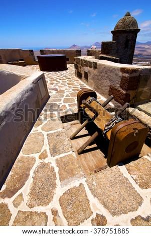 winch house  castillo de las coloradas  lanzarote  spain the old wall castle  sentry tower and door  in teguise  - stock photo