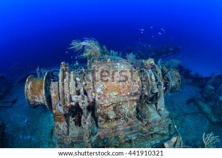 Winch machinery on an underwater shipwreck - stock photo