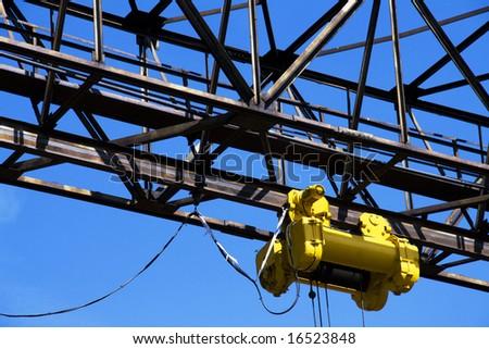 winch on gantry over blue sky - stock photo