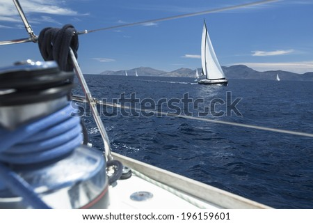 Winch with rope on sailing boat in the sea. - stock photo