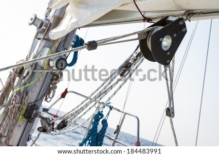winch with rope on sea yacht deck - stock photo
