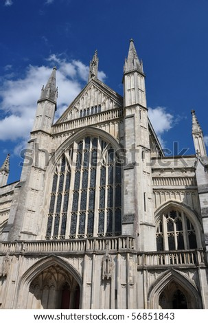 Winchester cathedral front facade and spires - stock photo