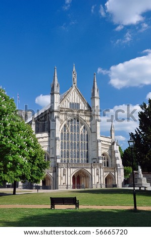 Winchester cathedral front facade and spires from a distance - stock photo