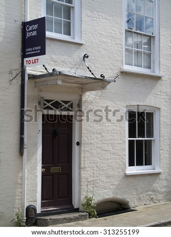 Winchester, Hampshire, England - September 4, 2015: Estate agent residential house to let sign - stock photo