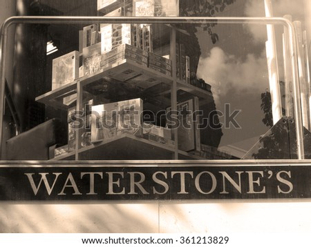 Winchester, High Street, Hampshire, England - August 15, 2015: Waterstones shop sign over store entrance, UK and Europe based book retailer, founded in 1982 by Tim Waterstone