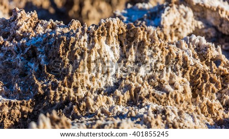 Wind and rain sculpt the salty spires into fascinating shapes. Incredibly serrated spires of salt. Salt has created complex structures. Devil's Golf Course, Death Valley National Park - stock photo