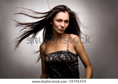 Wind and the attractive brunette - stock photo