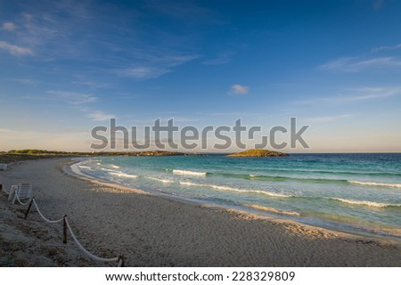 Wind and waves at beautiful sand beach on the north of Formentera island - stock photo