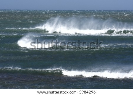 wind blowing spray on a rough sea