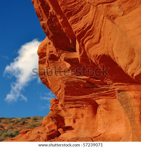 Wind carved surface of oxidized sandstone. - stock photo