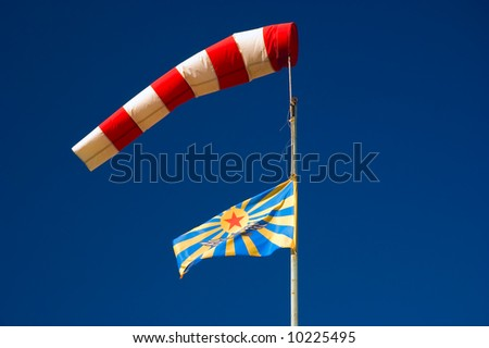 wind cone and soviet air force flag - stock photo