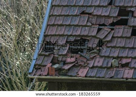 Wind damaged roof - stock photo