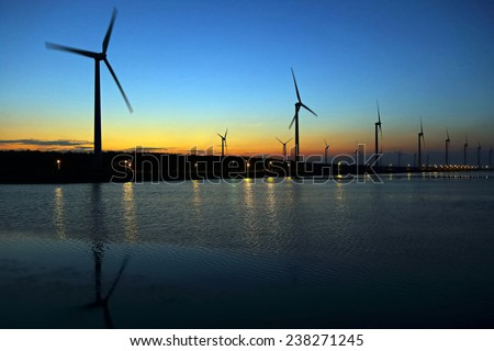 wind-driven generator with sunset in Taiwan - stock photo