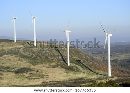 Wind energy business. Wind turbines in the mountain. - stock photo