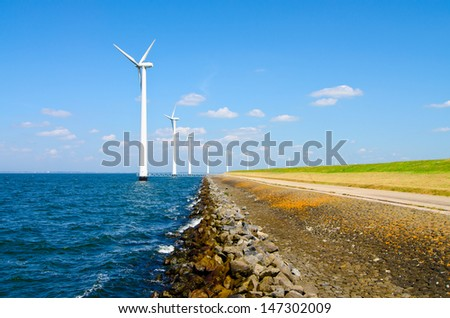 wind energy by windmills near the sea - stock photo