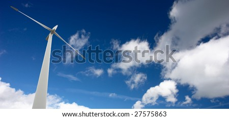 Wind energy conception with blue sky - stock photo