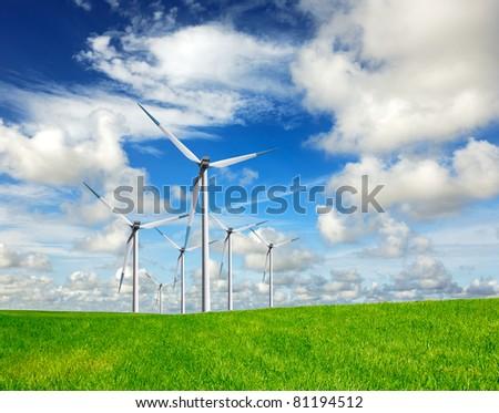 Wind energy on blue sky - stock photo