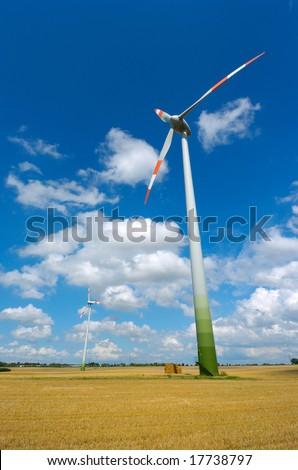 wind energy plant with cloudy sky