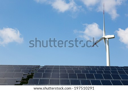 Wind energy turbine with some solar panels for clean electricity production
