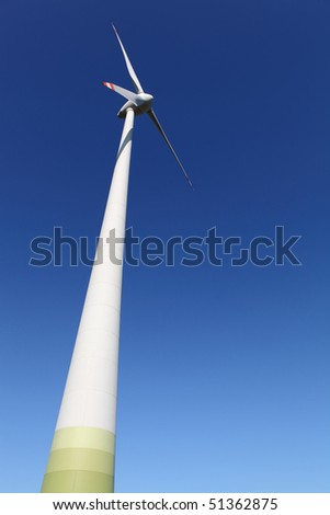 Wind engine in front of a perfect blue sky