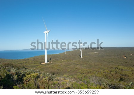 Wind farm along coast of Southern Ocean in Western Australia, producing clean renewable energy to town of Albany, summer sunny blue sky, copy space. - stock photo