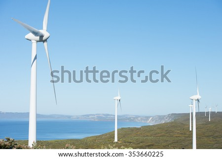 Wind farm along coast of Southern Ocean in Western Australia, producing renewable clean energy to town of Albany, summer sunny blue sky, copy space. - stock photo
