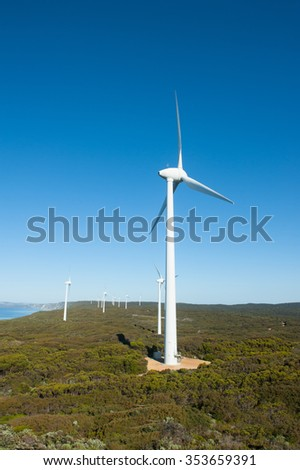 Wind farm along coast of Southern Ocean in Western Australia, producing renewable energy for town of Albany, summer sunny blue sky, copy space. - stock photo