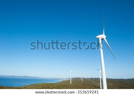 Wind farm along coast of Southern Ocean in Western Australia, supplying clean renewable energy to town of Albany, summer sunny blue sky, copy space. - stock photo
