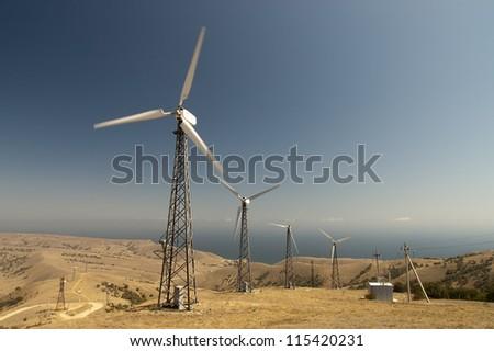 Wind farm at Cape. Ukraine. Crimea. - stock photo