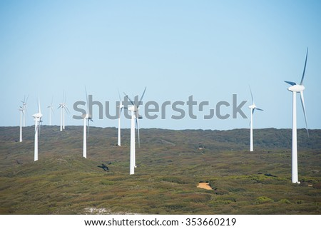 Wind farm at coast of Southern Ocean in Western Australia, supplying clean renewable energy to town Albany, summer sunny blue sky, copy space. - stock photo