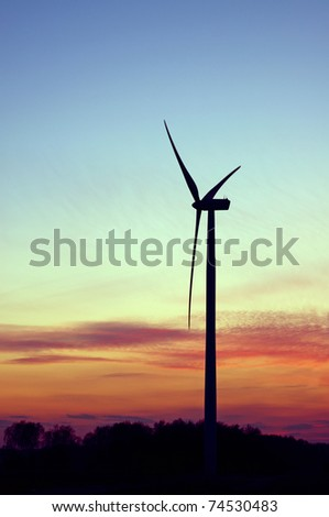 Wind farm at colorfull sunset - stock photo